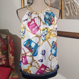 Caché  printed sleevesless top. Size M
